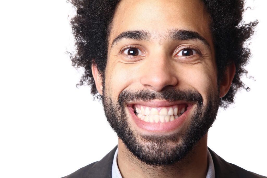 smiling man after adult braces glasgow treatment